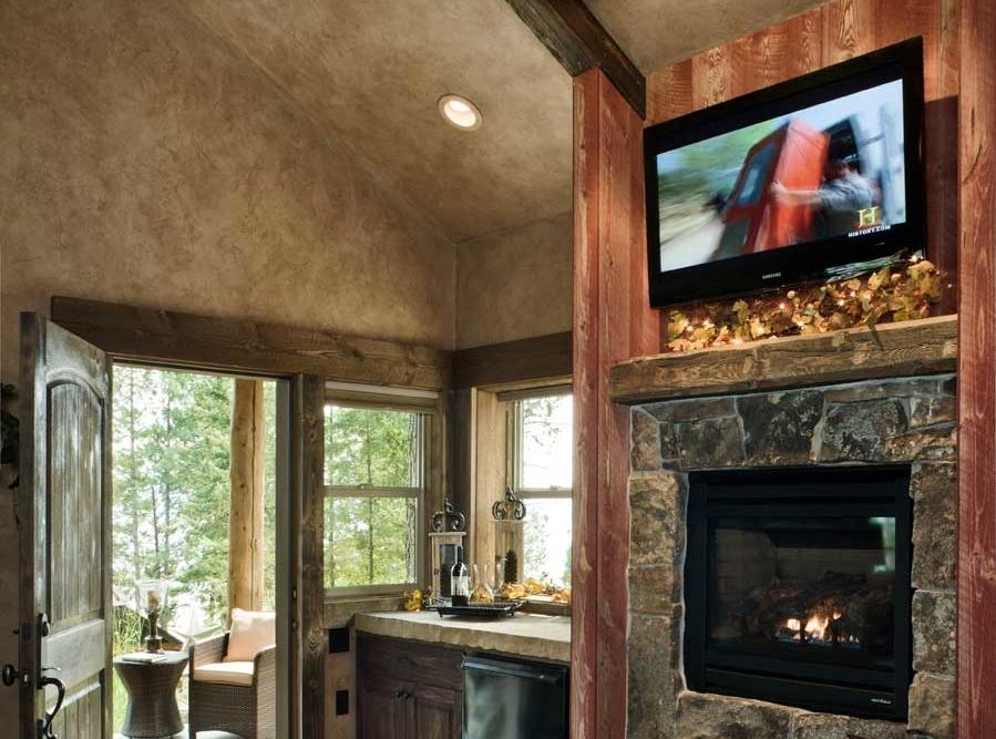 flathead lake retreat master bedroom fireplace